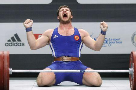 Khadzhimurat Akkaev of Russia celebrates during the men's 105kg weightlifting competition during the World Weightlifting Championships at Disney Village in Marne-la-Vallee outside Paris, November 12, 2011. REUTERS/Benoit Tessier