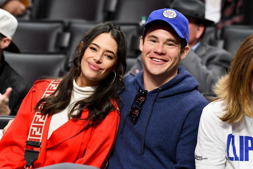 LOS ANGELES, CALIFORNIA - MARCH 08: Chloe Bridges and Adam DeVine attend a basketball game between the Los Angeles Clippers and the Los Angeles Lakers at Staples Center on March 08, 2020 in Los Angeles, California. (Photo by Allen Berezovsky/Getty Images)