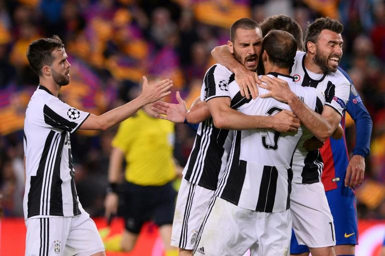 Juventus players celebrate their qualification at the end of the UEFA Champions League quarter-final match against Barcelona at the Camp Nou stadium in Barcelona on April 19, 2017
