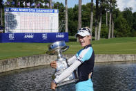 Nelly Korda of the U.S. holds the trophy after winning the KPMG Women's PGA Championship golf tournament, Sunday, June 27, 2021, in Johns Creek, Ga. (AP Photo/John Bazemore)