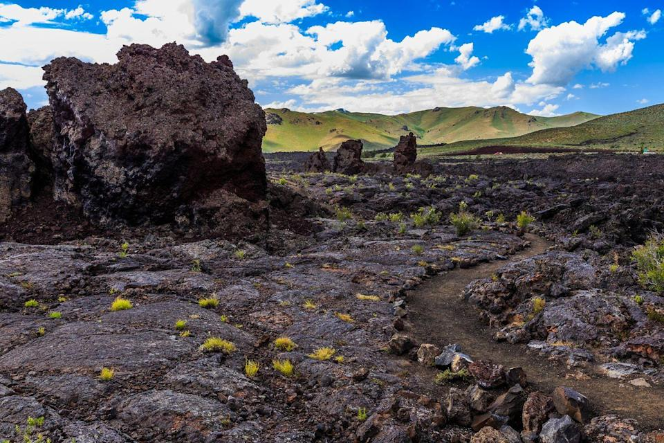 """<p><a href=""""https://www.nps.gov/crmo/index.htm"""" rel=""""nofollow noopener"""" target=""""_blank"""" data-ylk=""""slk:Craters of the Moon National Monument"""" class=""""link rapid-noclick-resp""""><strong>Craters of the Moon National Monument </strong></a></p><p>It's not hard to see why this park got its name. Lava flow left behind some truly bizarre landscaping details that actually look more like the surface of the moon than Earth. </p>"""