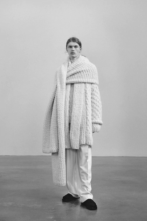 """<h2>Statement Scarves<br></h2><br>Lenny Kravitz called, <a href=""""https://www.refinery29.com/en-gb/blanket-scarves-women"""" rel=""""nofollow noopener"""" target=""""_blank"""" data-ylk=""""slk:he wants his scarf back"""" class=""""link rapid-noclick-resp"""">he wants his scarf back</a>. At Y/Project's menswear collection in January, oversized scarves hid the models' faces completely. At Ganni and The Row, fashion's favorite designers turned the standard winter accessory into even more of a statement, creating sweater-scarf hybrids that will have you asking, <em>Where does my scarf end and my sweater begin?</em> London-based designer Ka Wa Key followed suit, attaching rainbow, fuzzy scarves around the necks, heads, and bodies of its fall '21 lineup of models. <span class=""""copyright"""">Photo: Courtesy of The Row.</span>"""