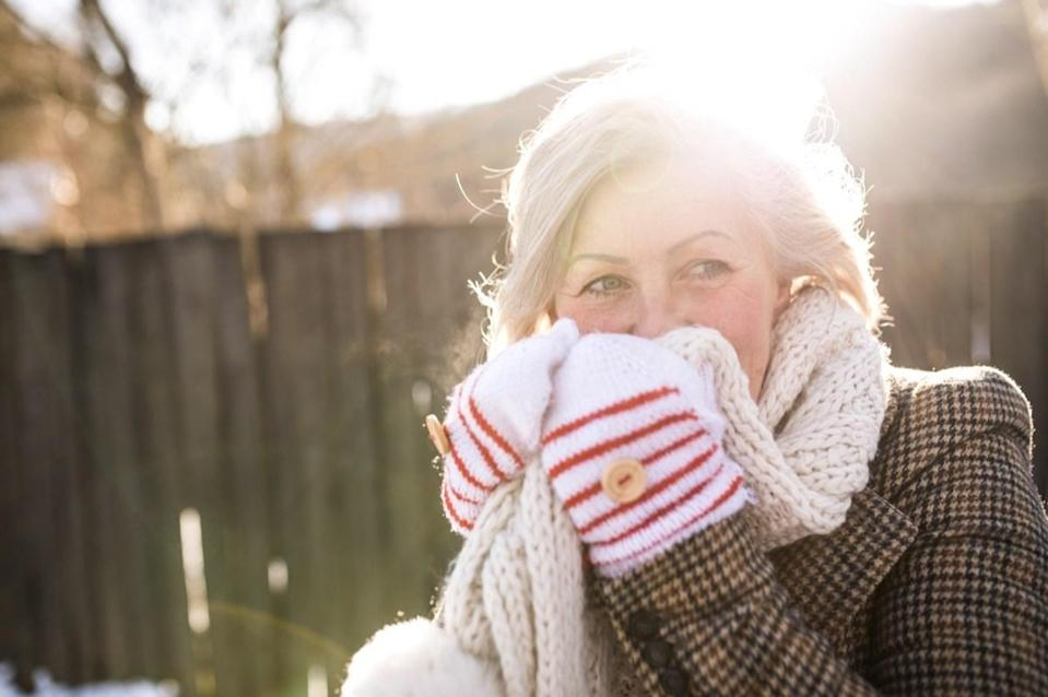 """<span>It is true that if you're not wearing a hat in cold temperatures, you will </span><span>lose body heat</span><span>, but not nearly the majority of your body heat. This notion became false common knowledge thanks to a 1970s edition of a <a href=""""https://books.google.com/books?id=VQBPDQAAQBAJ&pg=PT127&lpg=PT127&dq=U.S.+Army+survival+field+guide+%E2%80%9C40+to+45+percent+of+body+heat%22&source=bl&ots=v8zCna7rhy&sig=ACfU3U2lt5cJwUoD2XNK4KZgHWLCKX7QtA&hl=en&sa=X&ved=2ahUKEwjcvYv3lpvgAhUFd98KHY_JCTwQ6AEwCnoECAYQAQ#v=onepage&q=U.S.%20Army%20survival%20field%20guide%20%E2%80%9C40%20to%2045%20percent%20of%20body%20heat%22&f=false"""" rel=""""nofollow noopener"""" target=""""_blank"""" data-ylk=""""slk:U.S. Army survival field guide"""" class=""""link rapid-noclick-resp"""">U.S. Army survival field guide</a>. It that claimed you could lose 40 to 45 percent of your body heat from """"an unprotected head.""""</span> <span>But that's a bit of a stretch. </span>""""Your head comprises only about 10 percent of your body's total surface area,"""" according to primary care practice <a href=""""https://www.onemedical.com/blog/live-well/body-heat"""" rel=""""nofollow noopener"""" target=""""_blank"""" data-ylk=""""slk:One Medical"""" class=""""link rapid-noclick-resp"""">One Medical</a>. """"Therefore, it's probably more correct to say that about 10 percent of body heat is lost through your head—and that's if your entire body were to be equally insulated."""" And to see how frigid it gets across the U.S., check out <a href=""""https://bestlifeonline.com/coldest-temperature-ever-recorded/?utm_source=yahoo-news&utm_medium=feed&utm_campaign=yahoo-feed"""" rel=""""nofollow noopener"""" target=""""_blank"""" data-ylk=""""slk:The Coldest Temperature Ever Recorded in Every State"""" class=""""link rapid-noclick-resp"""">The Coldest Temperature Ever Recorded in Every State</a>."""