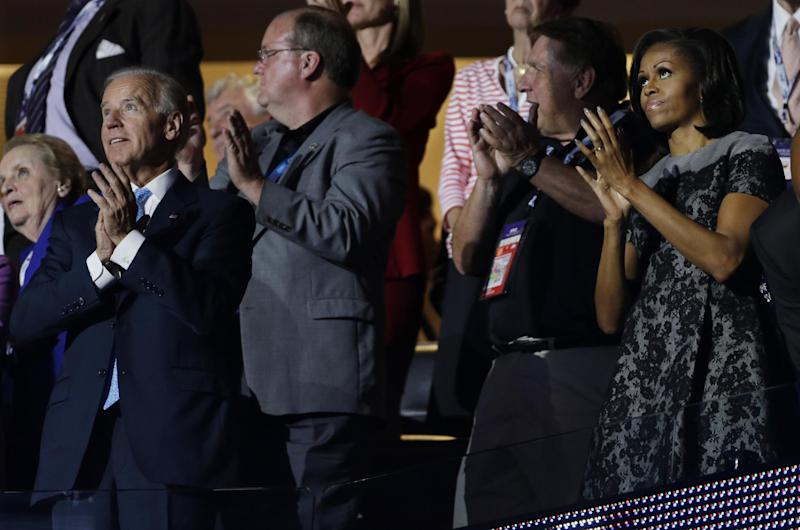Vice President Joe Biden and First lady Michelle Obama applaud after Sandra Fluke, attorney and women's rights activist's speech at the Democratic National Convention in Charlotte, N.C., on Wednesday, Sept. 5, 2012. (AP Photo/Charlie Neibergall)