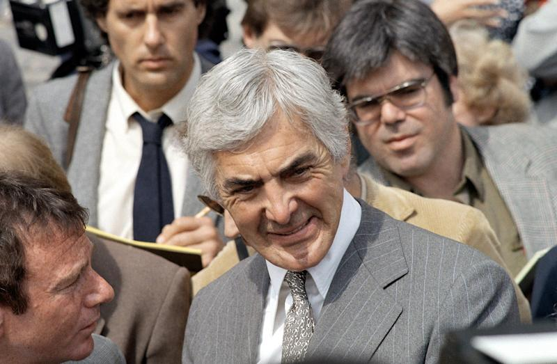 Automaker John DeLorean arrived at the Federal Courthouse to attend his trial on cocaine trafficking charges, March 13, 1984, Los Angeles, Calif. (AP Photo/Lennox McLendon)