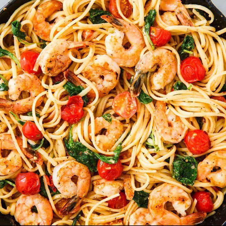 "<p>Linguine with tomatoes, greens, and prawns in a buttery sauce = bomb.</p><p>Get the <a href=""https://www.delish.com/uk/cooking/recipes/a30219265/creamy-shrimp-linguine-tomatoes-kale-lemon-zest-recipe/"" rel=""nofollow noopener"" target=""_blank"" data-ylk=""slk:Creamy Prawn Linguine"" class=""link rapid-noclick-resp"">Creamy Prawn Linguine</a> recipe.</p>"