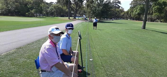 """Rusty MacDonald, 39, right, and his father, also Rusty, watch practice play at the RBC Heritage Wednesday. """"I can't tell you how nice it is to watch and what a beautiful day,"""" the senior MacDonald said."""