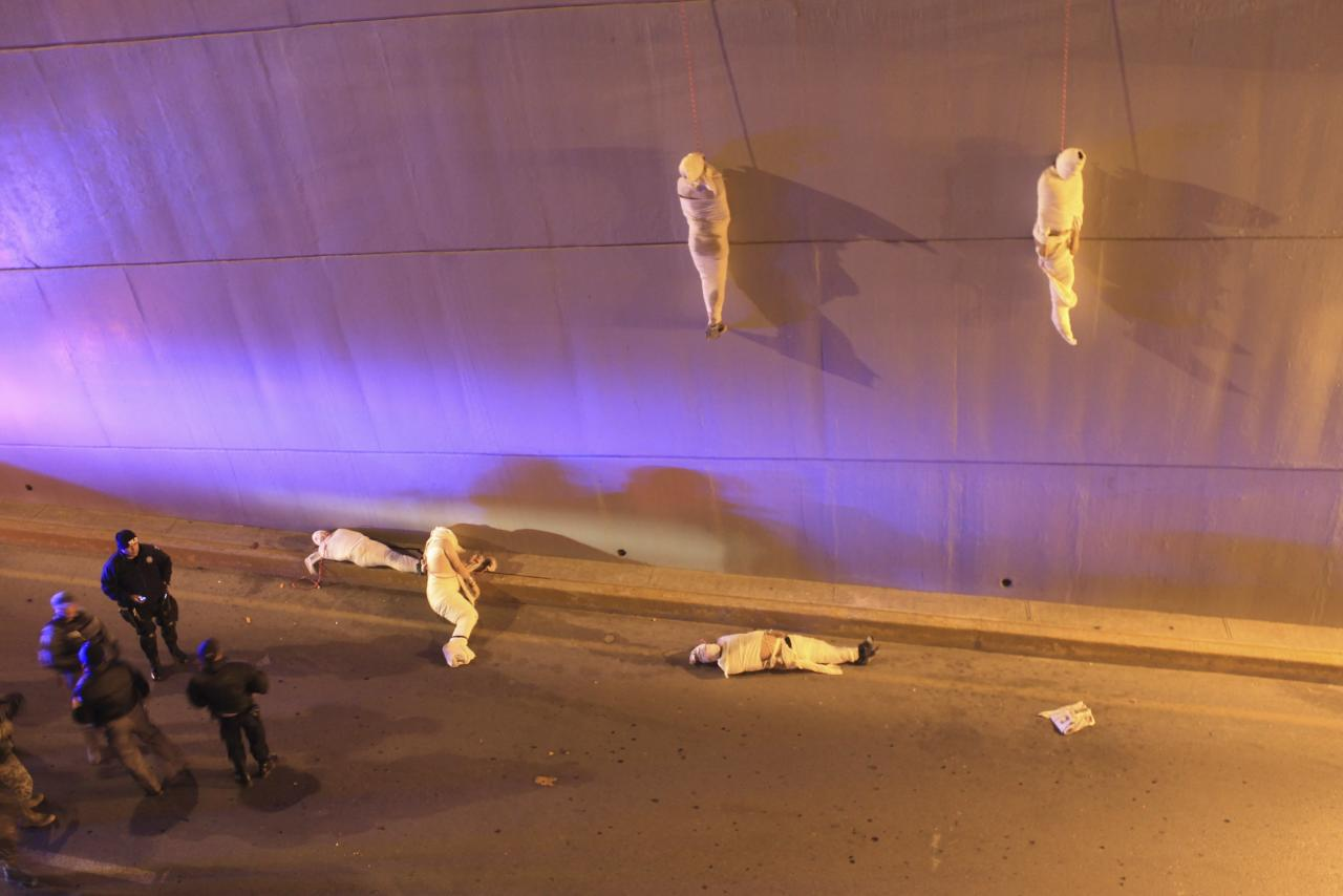 WORLD PRESS PHOTO CONTEST WINNERS. PICTURE 07 OF 19 Christopher Vanegas, a Mexican photographer working for La Vanguardia / El Guardian won the 3rd Prize Contemporary Issues Single category of the 2014 World Press Photo contest with this picture of police arriving at a crime scene where two bodies hang from a bridge; another three are on the floor in Saltillo, Coahuila, Mexico, taken March 8, 2013. The prize-winning entries of the World Press Photo Contest 2014, the world's largest annual press photography contest, were announced February 14, 2014. REUTERS/Christopher Vanegas/World Press Photo Handout via Reuters (MEXICO - Tags: MEDIA SOCIETY) NO COMMERCIAL OR BOOK SALES. NO SALES. NO ARCHIVES. FOR EDITORIAL USE ONLY. NOT FOR SALE FOR MARKETING OR ADVERTISING CAMPAIGNS. THIS IMAGE HAS BEEN SUPPLIED BY A THIRD PARTY. IT IS DISTRIBUTED, EXACTLY AS RECEIVED BY REUTERS, AS A SERVICE TO CLIENTS. MANDATORY CREDIT