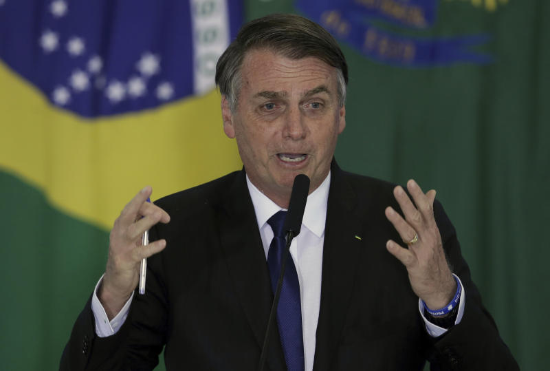 Brazil's President Jair Bolsonaro speaks during a ceremony where he signed a second decree that eases gun restrictions, during the signing ceremony at Planalto presidential palace in Brasilia, Brazil, Tuesday, May 7, 2019. The decree opens Brazil's market to guns and ammunition made outside of Brazil according to a summary of the decree. Gun owners can now buy between 1,000 -5,000 rounds of ammunition per year depending on their license, up from 50 rounds. Lower-ranking military members can now carry guns after 10 years of service. (AP Photo/Eraldo Peres)