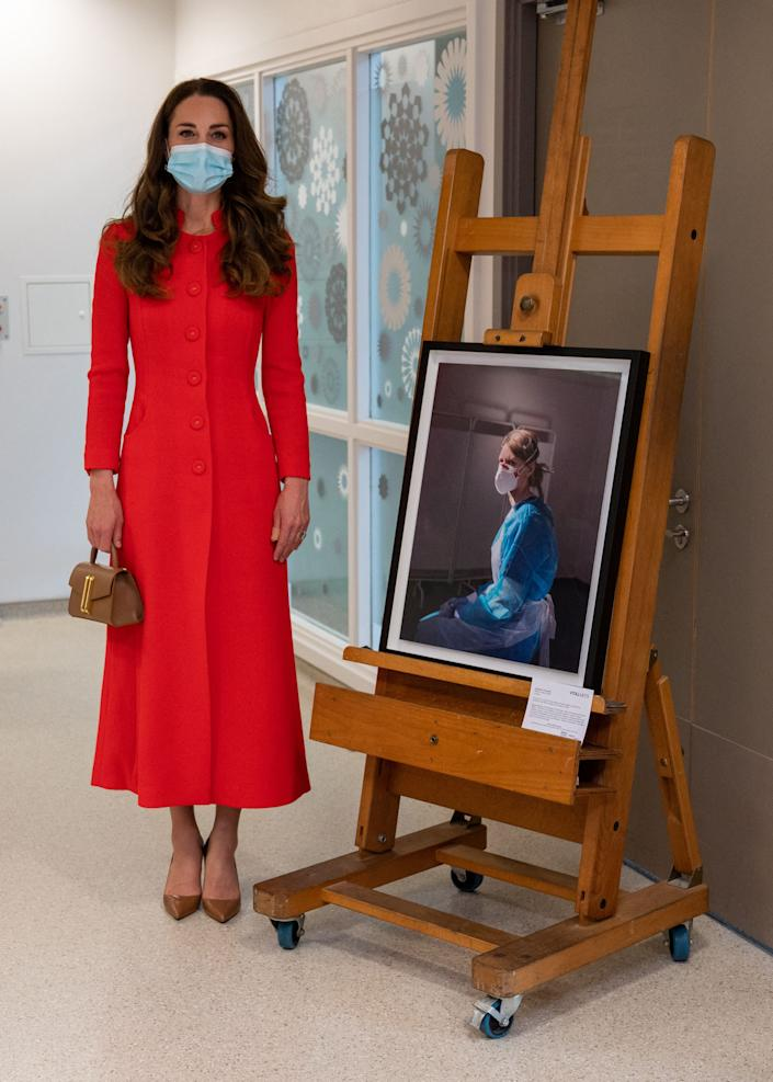 Britain's Catherine, Duchess of Cambridge looks at art on display during a visit to Royal London Hospital Whitechapel in east London, on May 7, 2021, to meet staff and hear how the hospital uses art to benefit patients and staff. (Photo by Arthur EDWARDS / POOL / AFP) (Photo by ARTHUR EDWARDS/POOL/AFP via Getty Images)