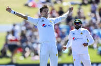 Pakistan bowler Shaheen Afridi celebrates the wicket of New Zealand batsman Ross Taylor during play on day one of the first cricket test between Pakistan and New Zealand at Bay Oval, Mount Maunganui, New Zealand, Saturday, Dec. 26, 2020. (Andrew Cornaga/Photosport via AP)