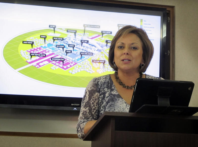 New Mexico Gov. Susana Martinez speaks during a news conference in Albuquerque, N.M. on Tuesday, May 8, 2012, where it was announced that Hobbs and Lea County had beat out a second finalist, Las Cruces, for a new $1 billion research center. The Center for Innovation, Technology and Testing - or CITE - will be a scientific ghost town developed to help researchers test everything from intelligent traffic systems and next-generation wireless networks to the latest in automated washing machines and self-flushing toilets. (AP Photo/Jeri Clausing)