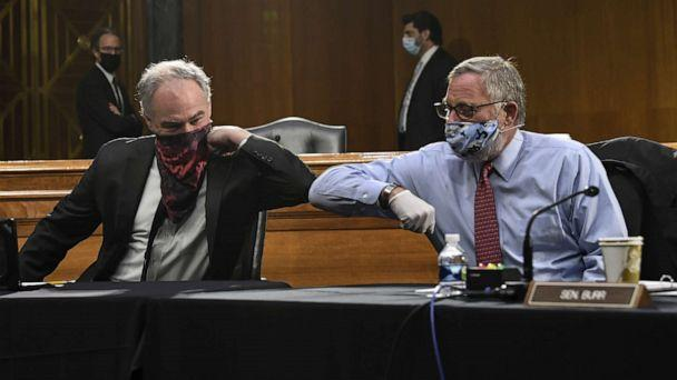 PHOTO: Senators Tim Kaine and Richard Burr greet each other with an elbow bump before the Senate Committee for Health, Education, Labor, and Pensions hearing on COVID-19, May 12, 2020, in Washington. (Toni L. Sandys/Getty Images)