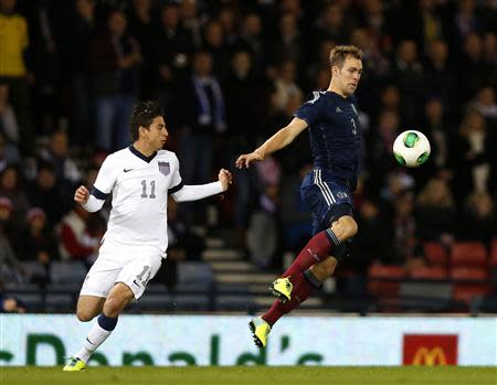 Scotland's Steven Whittaker (R) is challenged by Alejandro Bedoya of the U.S. during their international friendly soccer match at Hampden Park Stadium in Glasgow, Scotland, November 15, 2013. REUTERS/Russell Cheyne