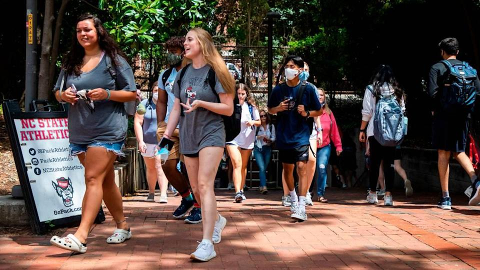 N.C. State students fill the sidewalks on the first day of classes for the fall semester, on Monday, Aug. 16, 2021, in Raleigh, N.C.