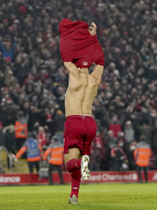 Liverpool's Mohamed Salah celebrates after scoring his side's second goal during the English Premier League soccer match between Liverpool and Manchester United at Anfield Stadium in Liverpool, Sunday, Jan. 19, 2020.(AP Photo/Jon Super)