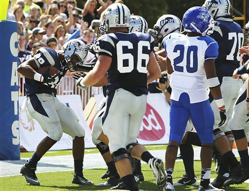 New Hampshire's Harold Spears (89) celebrates with teammates after scoring a touchdown in the first half of their NCAA college football game against Central Connecticut State,Saturday, Sept. 15, 2012,in Durham, N.H. New Hampshire won 43-10. (AP Photo/Cheryl Senter)