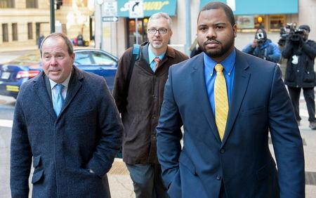 Baltimore Police Officer William Porter (R) and his attorneys Joseph Murtha (L) and Gary Proctor arrive at the courthouse for pretrial hearings in the case of Caeser Goodson in Baltimore, Maryland, January 6, 2016. REUTERS/Bryan Woolston