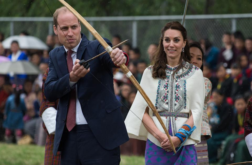 Kate did not look convinced when she watched Prince William prepare to fire an arrow at The Changlingmethang National Archery ground on tour in Thimphu in April 2016. (Roberto Schmidt/AFP)