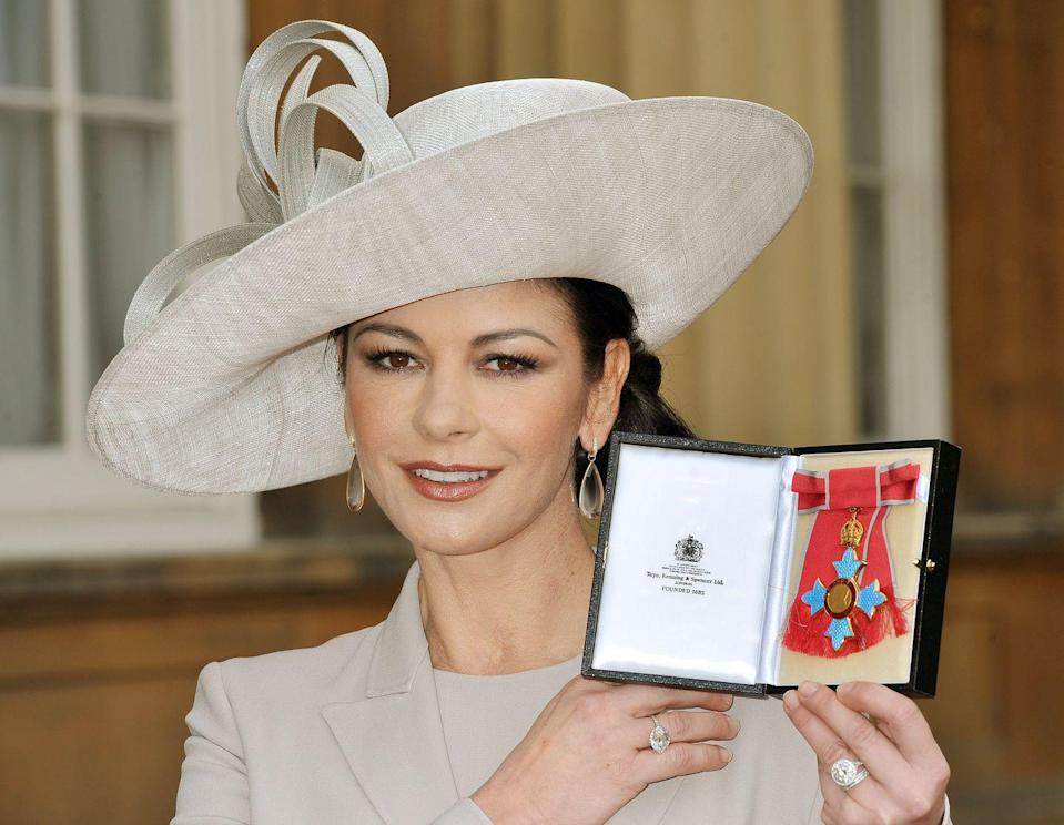 <p>Prince Charles appointed Zeta Jones a Commander of the Order of the British Empire (CBE) back in 2010.</p>