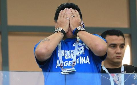 Diego Maradona hides head - Credit: GETTY IMAGES