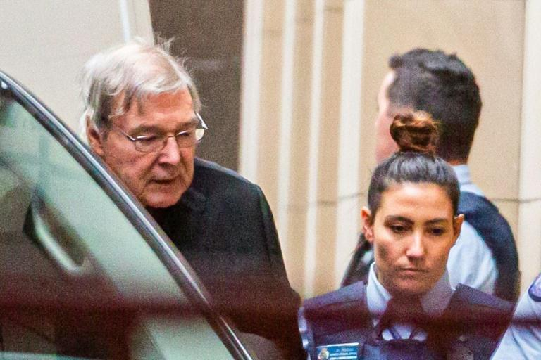 Australian Cardinal George Pell is escorted into the Supreme Court of Victoria in Melbourne at the start of his appeal process (AFP Photo/ASANKA BRENDON RATNAYAKE)