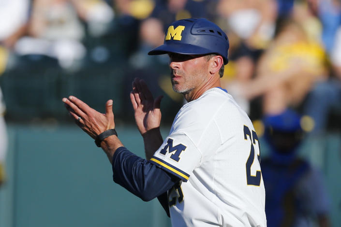 FILE - In this June 8, 2019, file photo, Michigan head coach Erik Bakich gestures during an NCAA college baseball tournament super regional game against UCLA in Los Angeles. A group of Power Five coaches led by Michigan's Erik Bakich is proposing a later start to the college baseball season to trim expenses in the post-coronavirus era, make the game more fan friendly and reduce injury risk to players. (AP Photo/Ringo H.W. Chiu, File)