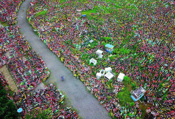 HEFEI, CHINA - AUGUST 16: An aerial view of the rental bikes detained by the local urban administration authority of Luyang district in Hefei in Anhui province on August 16, 2017 in Hefei, China. Tens of thousands of rental bikes parked at spots causing troubles to pedestrians and traffic in streets have been removed away by government authorities to the graveyards of the bikes while bike companies struggle to regulate the parking behavior of their users. PHOTOGRAPH BY Feature China / Barcroft Images London-T:+44 207 033 1031 E:hello@barcroftmedia.com - New York-T:+1 212 796 2458 E:hello@barcroftusa.com - New Delhi-T:+91 11 4053 2429 E:hello@barcroftindia.com www.barcroftimages.com (Photo credit should read Feature China / Barcroft Images / Barcroft Media via Getty Images)