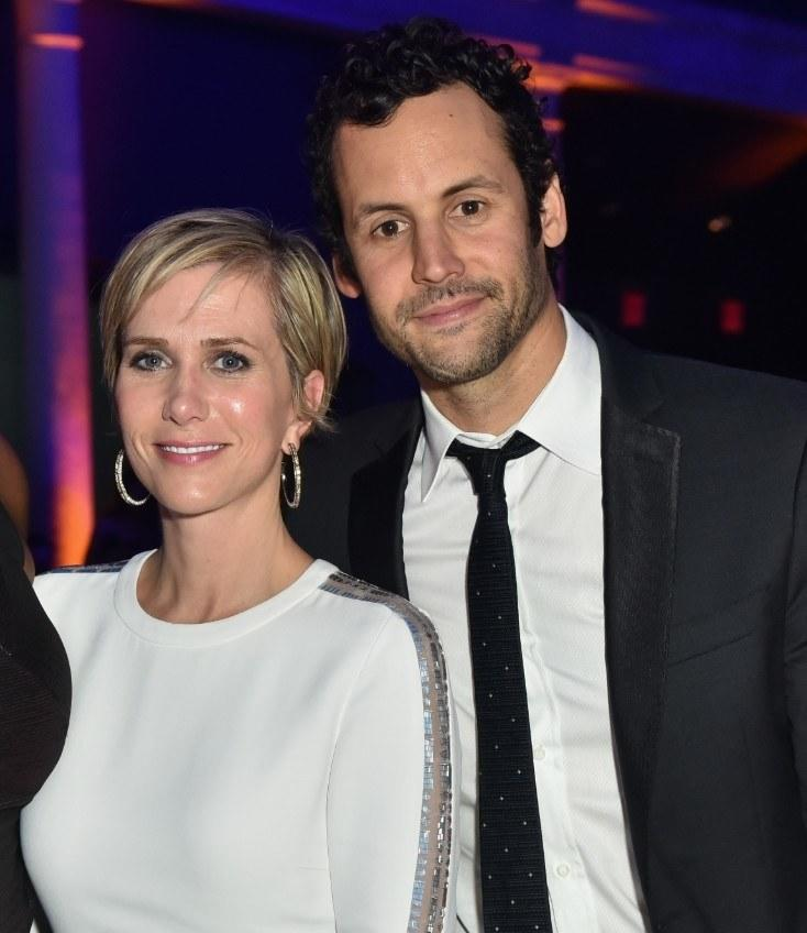 """<em>People</em> <a href=""""https://people.com/celebrity/celebrities-engaged-in-2019/?slide=7223277#7223277"""">confirmed</a> that Kristen Wiig and her actor/writer/producer boyfriend of three years, Avi Rothman, got engaged earlier this year after she was spotted wearing a ring in May."""
