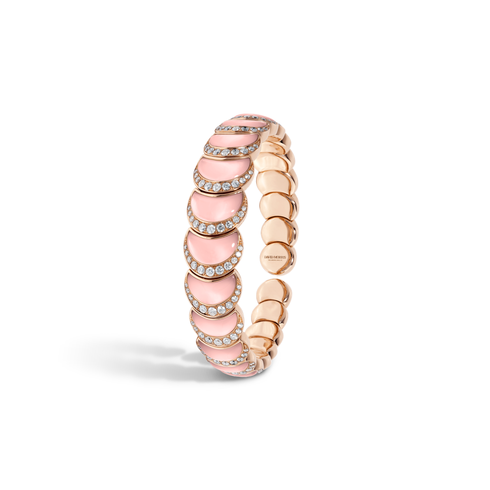 """<p><a class=""""body-btn-link"""" href=""""https://www.davidmorris.com/product/fortuna-flexi-bangle-in-pink-opal/"""" target=""""_blank"""">SHOP NOW</a></p><p>Inspired by the goddess of good fortune, David Morris' latest collection features crescent moon-shapes of polished pink opal, set with star-like white diamonds. </p><p>Pink opal, diamond and pink gold bangle, £19,600, David Morris</p>"""