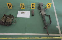Evidence items which belonged to suspected militants, Ali Kalora and Jaka Ramadan, are seen during a news conference at the Parigi Moutong police station in Parigi Moutong district, Central Sulawesi, Indonesia, Sunday, Sept. 19, 2021. Kalora, Indonesia's most wanted militant with ties to the Islamic State group, was killed Saturday in a shootout with security forces, the Indonesian military said, in a sweeping counterterrorism campaign against extremists in the remote mountain jungles. (AP Photo/Josua Marunduh)