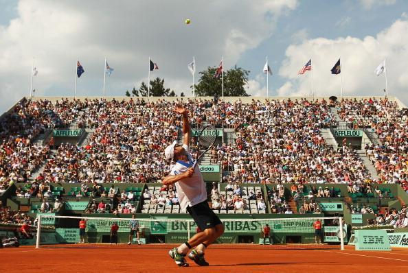 Andy Roddick of USA serves in his men's singles first round match against Nicolas Mahut of France during day 1 of the French Open at Roland Garros on May 27, 2012 in Paris, France. (Photo by Matthew Stockman/Getty Images)