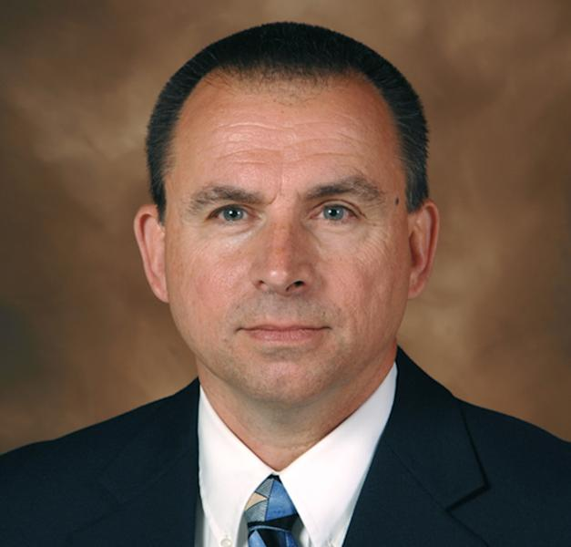 In this 2010 photo provided by the Iowa Department of Public Saftey is Special Agent in Charge Larry Hedlund of the Iowa Division of Criminal Investigation. The investigator who complained about the Iowa governor's speeding vehicle was fired following a disciplinary review Wednesday, July 17, 2013. (AP Photo/Iowa Department of Public Saftey)