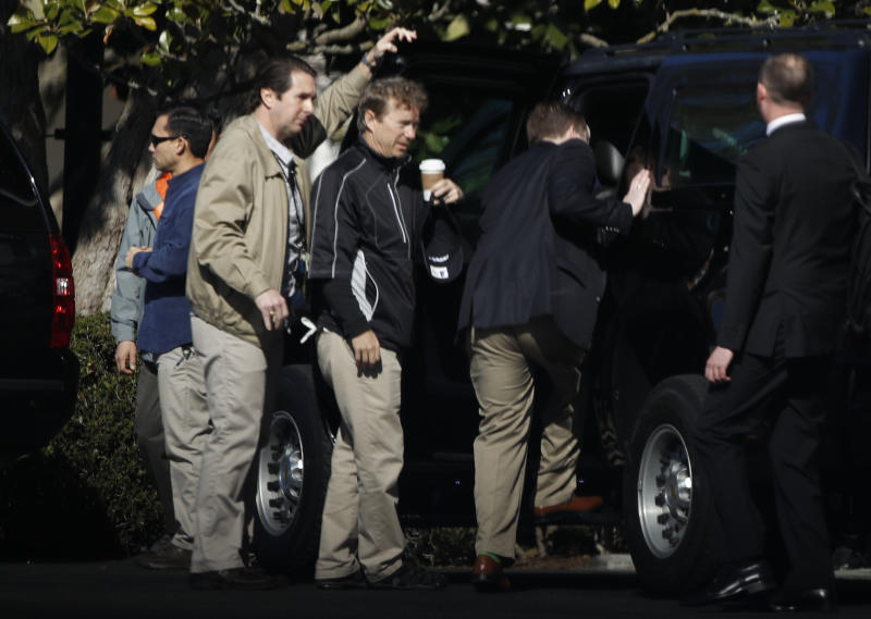 Sen. Rand Paul, R-Ky, center, waits for his turn to get in the presidential vehicle on the South Lawn driveway at the White House in Washington, Sunday, April 2, 2017. (AP Photo/Manuel Balce Ceneta)