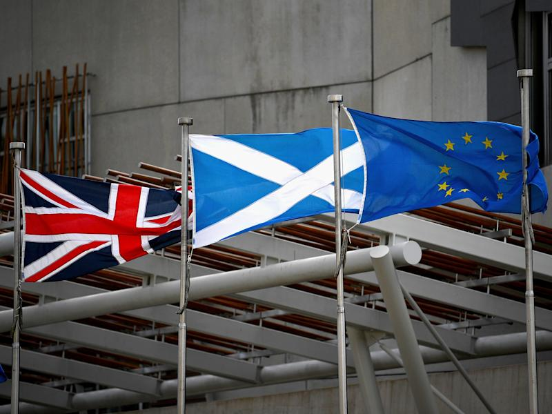 A Saltire, Union Jack and EU flags flutter in the wind outside the Scottish Parliament: Getty Images