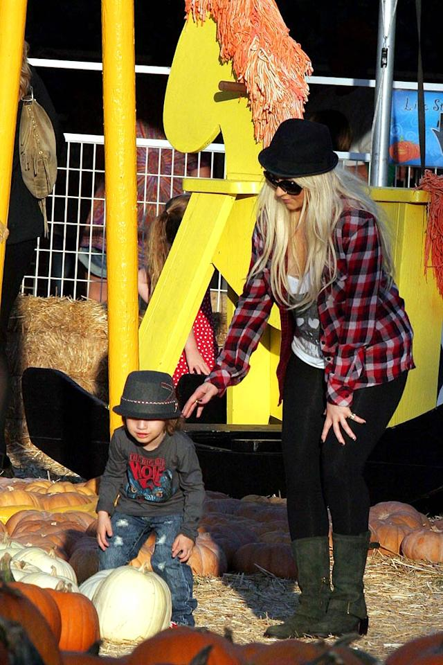 Christina Aguilera and son Max donned matching hipster hats as they searched for the perfect pumpkin at celeb hangout Mr. Bones Pumpkin Patch in West Hollywood, California over the weekend. (October 15, 2011)