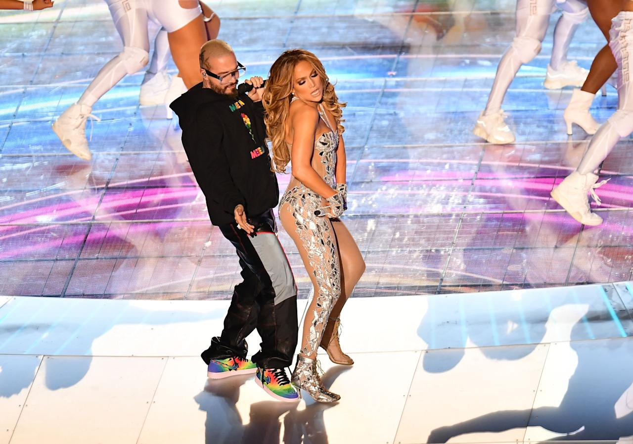 Jennifer Lopez and J Balvin perform during the halftime show of Super Bowl LIV between the Kansas City Chiefs and the San Francisco 49ers at Hard Rock Stadium in Miami Gardens, Florida, on February 2, 2020. (Photo by Angela Weiss / AFP)