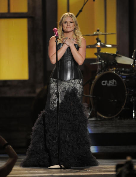 FILE - In this April 1, 2014 file photo, Miranda Lambert performs at the 47th Annual Academy of Country Music Awards in Las Vegas. The 2014 Academy of Country Music Awards in Las Vegas will air live Sunday night, April 6, 2014, from 8-11 p.m. EDT on CBS. Several awards, including top honor entertainer of the year, will be announced during the broadcast, to be hosted by Blake Shelton and Luke Bryan. Shelton, Bryan, George Strait, Miranda Lambert, Jason Aldean, Keith Urban, Tim McGraw, Shakira and Stevie Nicks are scheduled to perform.(AP Photo/Mark J. Terrill, File)