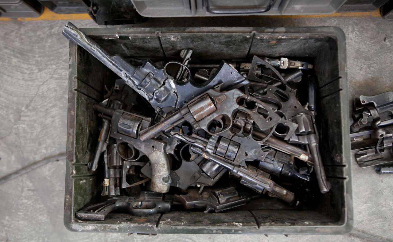 "Weapons fill a bin in the studio of Mexican artist Pedro Reyes in Mexico City,Tuesday, Feb. 13, 2013. The guns that have caused so many deaths in northern Mexico are transformed into musical instruments by Reyes. The Mexican artist said he was able to choose his instruments from about 6,700 guns that were turned in or seized by the army and police in Ciudad Juarez, a city of about 1.3 million people that averaged about 10 killings a day at the height of the violence. Reyes already was known for a 2008 project called ""Palas por Pistolas,"" or ""Pistols to Shovels,"" in which he melted down 1,527 weapons to make the same number of shovels to plant the same number of trees. (AP Photo/Eduardo Verdugo)"