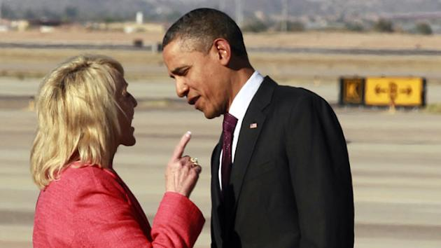 Brewer greets Obama on the tarmac in Phoenix, Jan. 25, 2012. (AP/File)