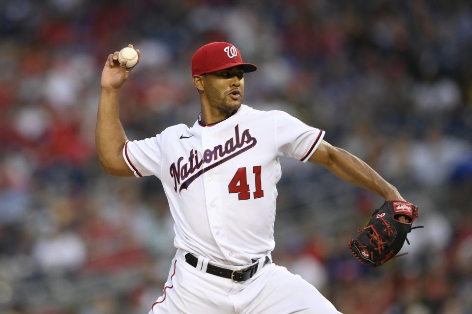 Washington Nationals starting pitcher Joe Ross delivers during the third inning of a baseball game against the Chicago Cubs, Saturday, July 31, 2021, in Washington. (AP Photo/Nick Wass)