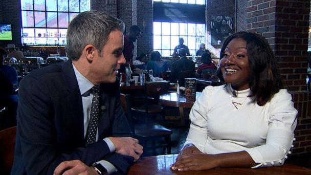 PHOTO: ABC News' Devin Dwyer talks with Alisha Cromartie at Paschal's Soulfood about impeachment and the Democratic presidential primary, Nov. 17, 2019. (ABC News)