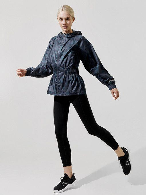 """<p><strong>SWEATY BETTY</strong></p><p>carbon38.com</p><p><strong>$195.00</strong></p><p><a href=""""https://go.redirectingat.com?id=74968X1596630&url=https%3A%2F%2Fwww.carbon38.com%2Fproduct%2Fstorm-seeker-batwing-jacket&sref=https%3A%2F%2Fwww.cosmopolitan.com%2Fstyle-beauty%2Ffashion%2Fg32950282%2Fcute-rainy-day-outfit-ideas%2F"""" rel=""""nofollow noopener"""" target=""""_blank"""" data-ylk=""""slk:Shop Now"""" class=""""link rapid-noclick-resp"""">Shop Now</a></p><p>A camo-printed navy jacket with a hood and and cinched waist is both functional and stylish. Pair it with black leggings, sneakers (or rainboots!) to make a sporty ensemble for those dreary days. </p>"""
