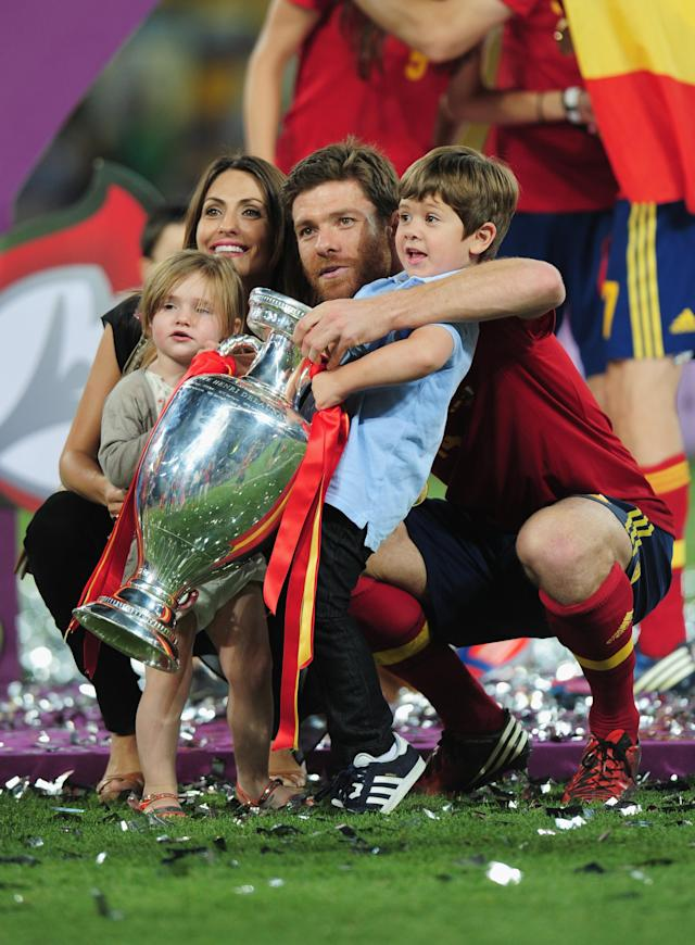 KIEV, UKRAINE - JULY 01: Xabi Alonso (C) of Spain celebrates their victory with his wife Nagore Aramburu and their children Jontxu (R) and Ane (L) during the UEFA EURO 2012 final match between Spain and Italy at the Olympic Stadium on July 1, 2012 in Kiev, Ukraine. (Photo by Shaun Botterill/Getty Images)