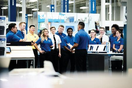 Best Buy store employees hold a meeting at a Best Buy in Pasadena