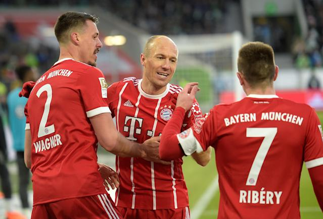 Soccer Football - Bundesliga - VfL Wolfsburg vs Bayern Munich - Volkswagen Arena, Wolfsburg, Germany - February 17, 2018 Bayern Munich's Sandro Wagner celebrates scoring their first goal with Arjen Robben and Franck Ribery REUTERS/Fabian Bimmer DFL RULES TO LIMIT THE ONLINE USAGE DURING MATCH TIME TO 15 PICTURES PER GAME. IMAGE SEQUENCES TO SIMULATE VIDEO IS NOT ALLOWED AT ANY TIME. FOR FURTHER QUERIES PLEASE CONTACT DFL DIRECTLY AT + 49 69 650050
