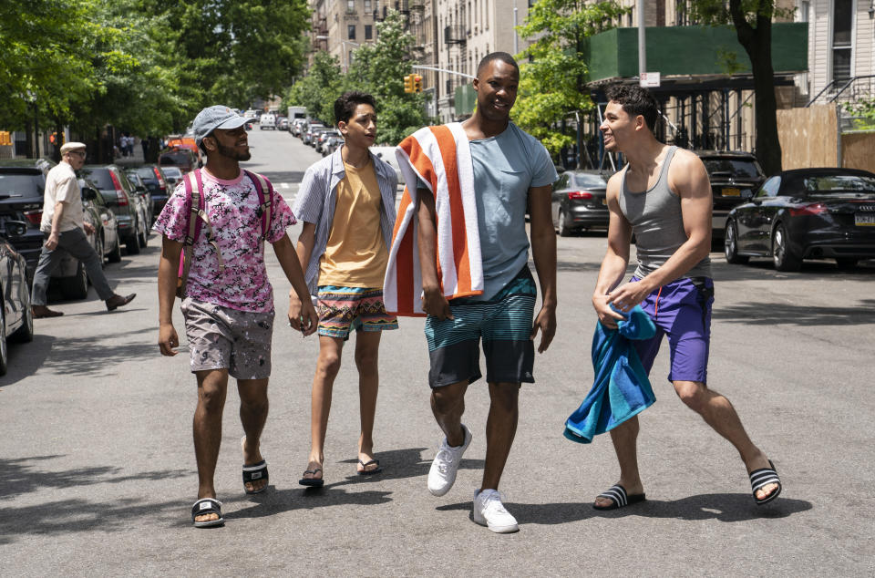 """This image released by Warner Bros. Pictures shows, from left, Noah Catala, from left, Gregory Diaz IV, Corey Hawkins and Anthony Ramos in a scene from """"In the Heights."""" (Macall Polay/Warner Bros. Pictures via AP)"""