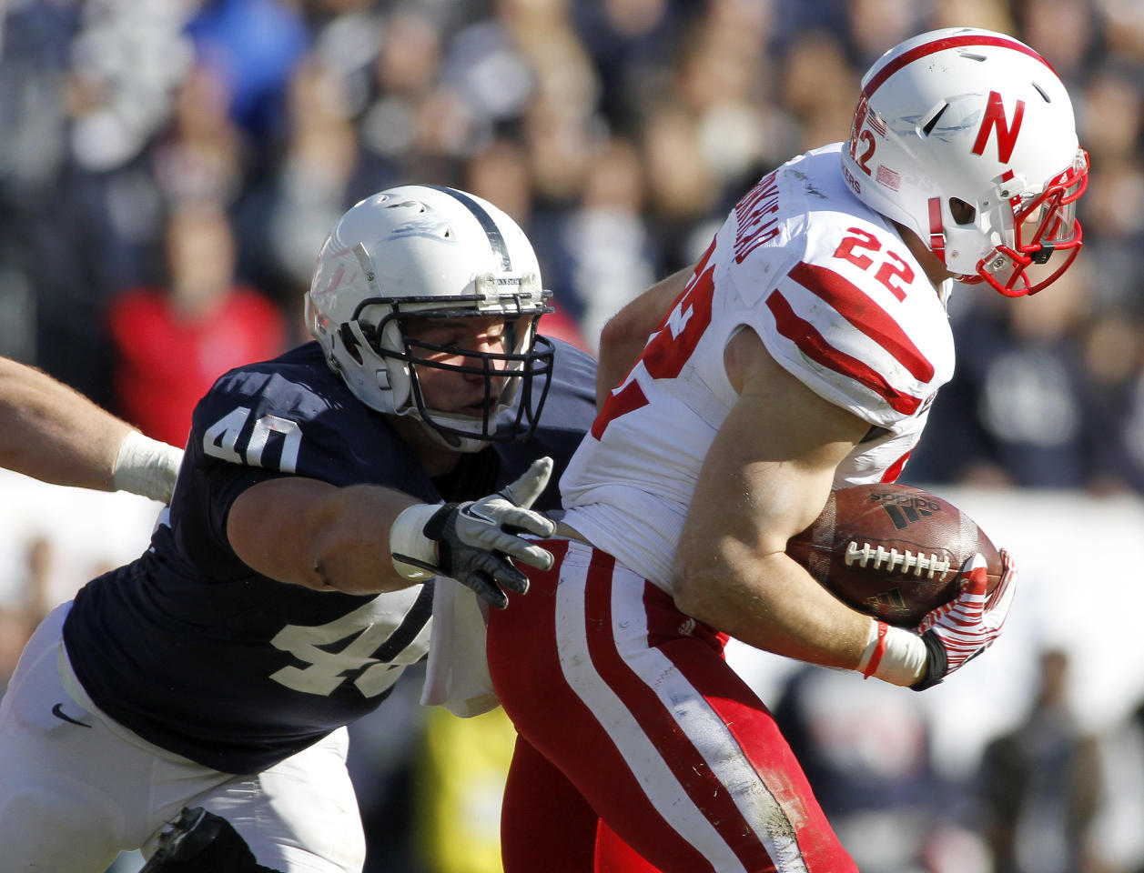 STATE COLLEGE, PA - NOVEMBER 12:  Glenn Carson #40 of the Penn State Nittany Lions tackles Rex Burkhead #22 of the Nebraska Cornhuskers during the game on November 12, 2011 at Beaver Stadium in State College, Pennsylvania.  (Photo by Justin K. Aller/Getty Images)