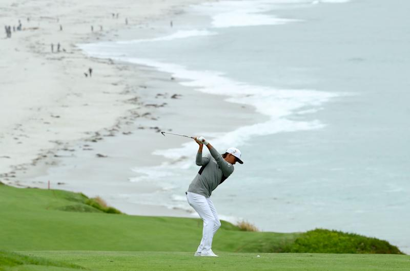 Rickie Fowler on the ninth, friends in the distance. (Getty Images)
