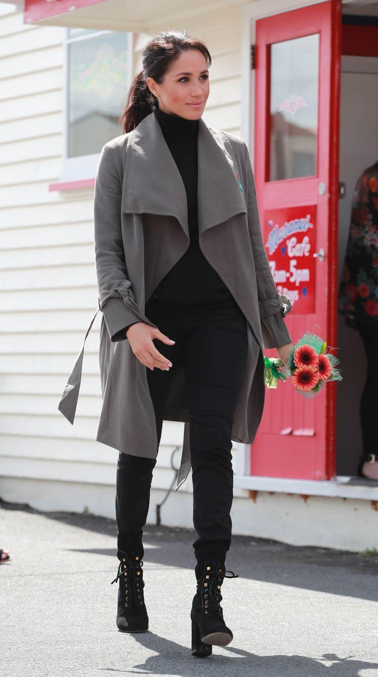 """<p>Markle wore the <a href=""""https://www.shopbop.com/ellayne-trench-club-monaco/vp/v=1/1524262335.htm"""" rel=""""nofollow noopener"""" target=""""_blank"""" data-ylk=""""slk:'Ellayne' trench coat by favoured brand Club Monaco"""" class=""""link rapid-noclick-resp"""">'Ellayne' trench coat by favoured brand Club Monaco</a>, the<a href=""""https://outlanddenim.co.uk/collections/women-1/products/harriet-in-black-1"""" rel=""""nofollow noopener"""" target=""""_blank"""" data-ylk=""""slk:'Harriet' jeans by Outland Denim"""" class=""""link rapid-noclick-resp""""> 'Harriet' jeans by Outland Denim</a> she has been seen wearing before this tour and the <a href=""""https://www.farfetch.com/uk/shopping/women/stuart-weitzman-veruka-lace-up-boots-item-13327174.aspx?storeid=9702&size=27&pid=googleadwords_int&af_channel=Search&c=629762120&af_c_id=629762120&af_keywords=pla-384855392548&af_adset_id=47496141593&af_ad_id=218094575186&is_retargeting=true&shopping=yes&gclid=EAIaIQobChMIvLqP3M6r3gIVg-F3Ch054gOeEAQYASABEgK3yPD_BwE"""" rel=""""nofollow noopener"""" target=""""_blank"""" data-ylk=""""slk:'Veruka' boots"""" class=""""link rapid-noclick-resp"""">'Veruka' boots</a> by <a href=""""https://www.net-a-porter.com/gb/en/Shop/Designers/Stuart_Weitzman/Shoes?cm_mmc=GoogleUK--c-_-NAP_EN_UK_London-_-NAP+-+INTL+-+London+-+Designer_Stuart+Weitzman+-+BT--Stuart+Weitzman+-+Shoes+-+Boots-_-%2Bstuart+%2Bweitzman+%2Bboots_b_kwd-20169570148_INTL&gclid=EAIaIQobChMIvLqP3M6r3gIVg-F3Ch054gOeEAAYAiAAEgLoa_D_BwE&gclsrc=aw.ds&pn=1&npp=60&image_view=product&dScroll=0"""" rel=""""nofollow noopener"""" target=""""_blank"""" data-ylk=""""slk:Stuart Weitzman"""" class=""""link rapid-noclick-resp"""">Stuart Weitzman</a>.</p>"""